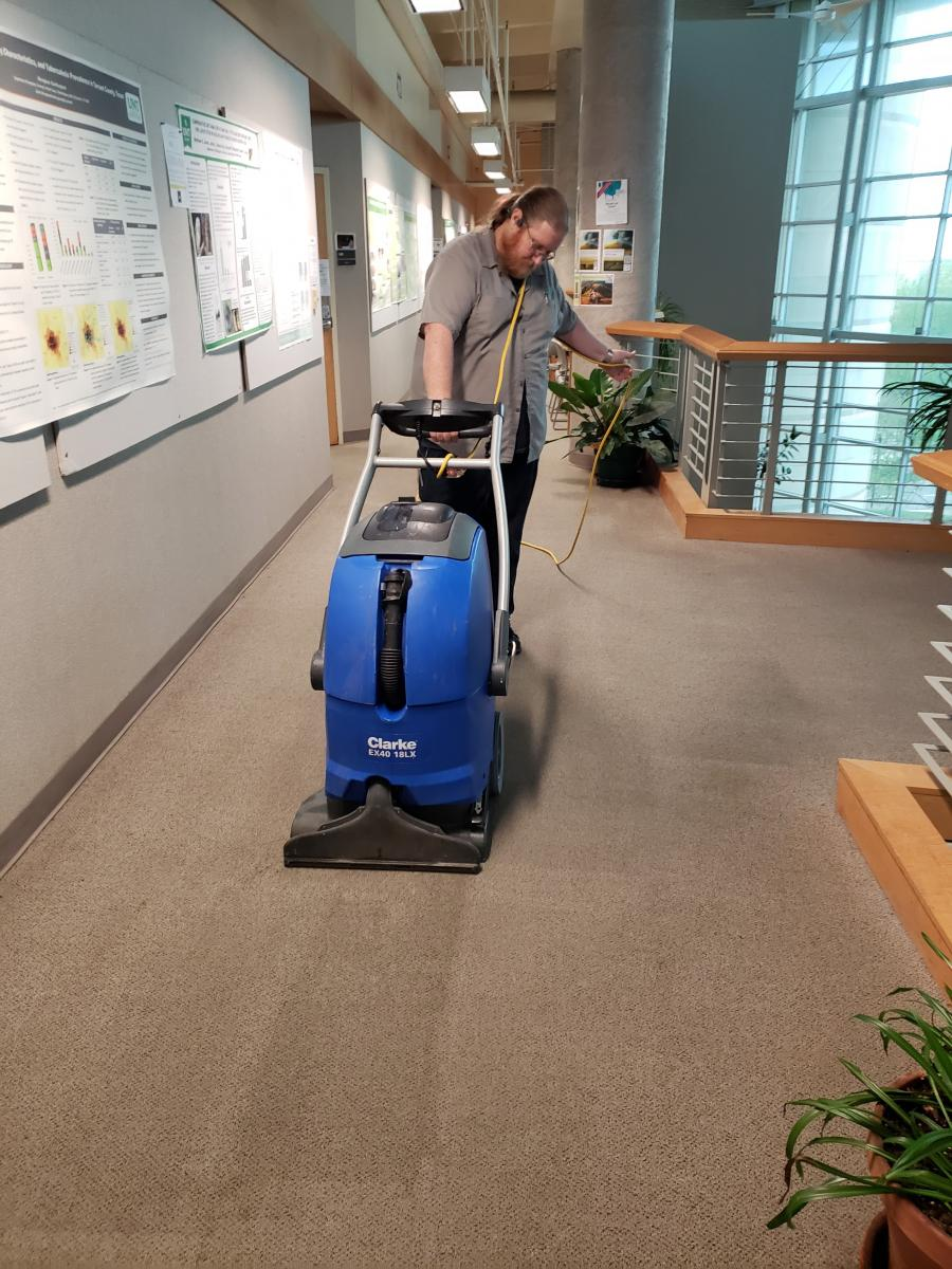 Van Cross cleaning carpet