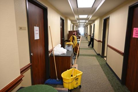 View of resident hall corridor with cleaning equipment
