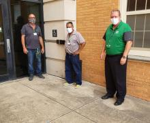 Staff standing in front of McConnell Hall hands-free entry