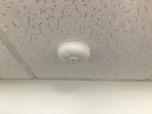Picture of occupancy sensor in ceiling.