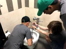 Toilet being fixed
